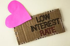 Handwriting text Low Interest Rate. Concept meaning Manage money wisely pay lesser rates save higher written on Tear Cardboard Pie. Handwriting text Low Interest stock images