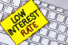 Handwriting text Low Interest Rate. Concept meaning Manage money wisely pay lesser rates save higher written on Yellow Sticky Note. Handwriting text Low Interest Stock Photos