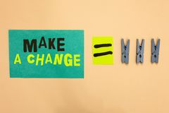 Handwriting text Make A Change. Concept meaning Create a Difference Alteration Have an Effect Metamorphose Turquoise paper reminde. R equal sign several stock photos