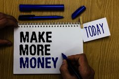 Handwriting text Make More Money. Concept meaning Increase your incomes salary benefits Work harder Ambition Man holding marker no. Tebook clothespin reminder royalty free stock photography
