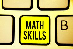Handwriting text Math Skills. Concept meaning starting to learn how to count numbers add divide use equation Keyboard yellow key I stock images