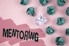 Handwriting text Mentoring. Concept meaning To give advice or support to a younger less experienced person written on Painted Pink. Handwriting text Mentoring royalty free stock images