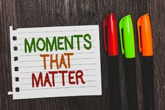 Handwriting text Moments That Matter. Concept meaning Meaningful positive happy memorable important times Colorful words with whit. E page red green orange pen stock photography