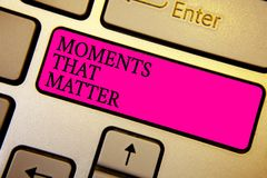 Handwriting text Moments That Matter. Concept meaning Meaningful positive happy memorable important times Crystal orange computer. Keyboard pink button written royalty free stock photography