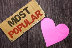 Handwriting text Most Popular. Concept meaning Top Rating Bestseller Favorite Product or Artist 1st in ranking written on Cardboar. Handwriting text Most Popular Royalty Free Stock Photo