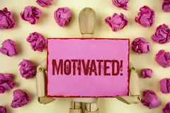 Handwriting text Motivated Motivational Call. Concept meaning Willing to do something Inspired Confident written on Sticky Note pa. Handwriting text Motivated Stock Image