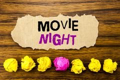 Handwriting text Movie Night. Concept for Wathing Movies Written on sticky note paper reminder, wooden background with sticky,. Handwriting text Movie Night stock images
