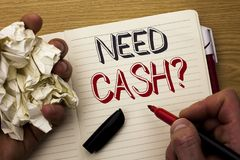 Handwriting text Need Cash Question. Concept meaning Wealth Question Needy Currency Money Advice Conceptual written by Man on Note stock photo