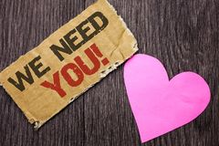 Handwriting text We Need You Motivational Call. Concept meaning Company wants to recruit Employee required written on Cardboard Pi royalty free stock photography