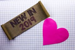 Handwriting text New In 2019. Concept meaning Fresh Era Latest Year Period Season Annual Coming Modern written on Cardboard Piece. Handwriting text New In 2019 stock photography