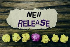 Handwriting text New Release . Concept for Technology Software Update Written on sticky note paper reminder, wooden background w. Handwriting text New Release stock photography