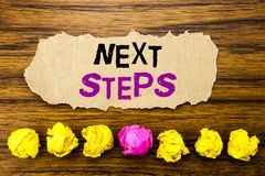 Handwriting text   Next Steps. Concept for Future Golas and Target Written on sticky note paper reminder, wooden background with s. Handwriting text   Next Steps Royalty Free Stock Photography