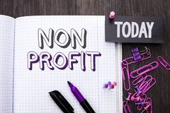 Handwriting text Non Profit. Concept meaning Charitable Wrothless Philanthropy Aid Unlucrative Profitless written on Notebook Book. Handwriting text Non Profit royalty free stock images