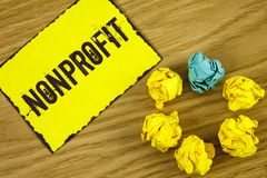 Handwriting text Nonprofit. Concept meaning Activities that do not generate revenues to the executor written on Sticky Note paper. Handwriting text Nonprofit Royalty Free Stock Photo