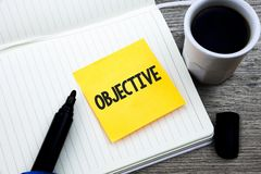 Handwriting text Objective. Concept meaning Goal planned to be achieved Desired target Company mission Study material folder card. Register notebook pen cap tea royalty free stock image