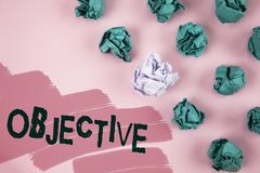 Handwriting text Objective. Concept meaning Goal planned to be achieved Desired target Company mission written on Painted Pink bac. Handwriting text Objective royalty free stock images