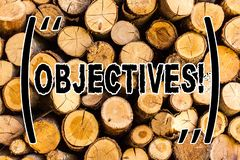 Handwriting text Objectives. Concept meaning Goals planned to be achieved Desired targets Wooden background vintage wood wild. Message ideas intentions thoughts royalty free stock photo