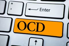Handwriting text Ocd. Concept meaning Obsessive Compulsive Disorder Psychological Illness Medical Condition written on Orange Key. Handwriting text Ocd. Concept Stock Photos