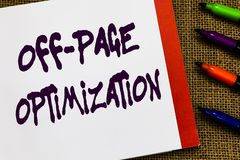 Handwriting text Off Page Optimization. Concept meaning Website External Process Promotional Method Ranking Open. Notebook page jute background colorful markers royalty free stock photo