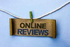 Handwriting text Online Reviews. Concept meaning Internet Evaluations Customer Rating Opinions Satisfaction written on Cardboard P. Handwriting text Online Royalty Free Stock Photo