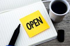 Handwriting text Open. Concept meaning Allow things to pass through or for immediate use Contrary of closed Study material folder. Card register notebook pen royalty free stock image
