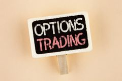 Handwriting text Options Trading. Concept meaning Options trading investment commodities stock market analysis written on Wooden N. Handwriting text Options Stock Photography