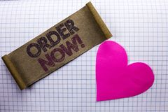 Handwriting text Order Now. Concept meaning Buy Purchase Order Deal Sale Promotion Shop Product Register written on Cardboard Piec. Handwriting text Order Now Royalty Free Stock Photo
