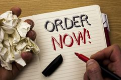 Handwriting text Order Now. Concept meaning Buy Purchase Order Deal Sale Promotion Shop Product Register written by Man on Noteboo. Handwriting text Order Now Royalty Free Stock Images