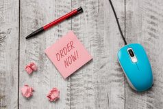 Handwriting text Order Now. Concept meaning confirmed request by one party to another to buy sell Writing equipment and. Handwriting text Order Now. Conceptual stock images