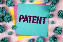 Handwriting text Patent. Concept meaning License that gives rights for using selling making a product written on Sticky Note Paper. Handwriting text Patent royalty free stock photo