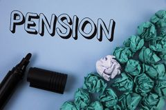 Handwriting text Pension. Concept meaning Income seniors earn after retirement Saves for elderly years written on Plain Blue backg. Handwriting text Pension Stock Photos