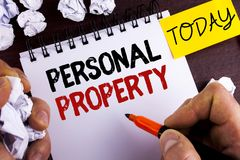 Handwriting text Personal Property. Concept meaning Belongings possessions assets private individual owner written by Man on Notep. Handwriting text Personal Stock Photography