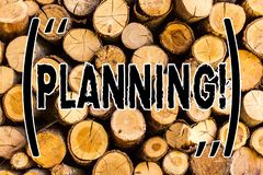 Handwriting text Planning. Concept meaning Defining strategies for achieving a goal Process of making plans Wooden background. Vintage wood wild message ideas royalty free stock image