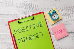 Handwriting text Positive Mindset. Concept meaning mental attitude in wich you expect favorable results Metal clipboard. Handwriting text Positive Mindset royalty free stock images