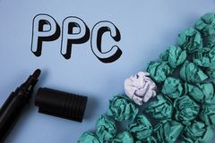 Handwriting text Ppc. Concept meaning Pay Per Click Advertising Strategies Direct Traffic to Websites written on Plain Blue backgr. Handwriting text Ppc. Concept royalty free stock photos