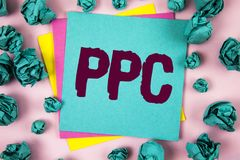 Handwriting text Ppc. Concept meaning Pay Per Click Advertising Strategies Direct Traffic to Websites written on Sticky Note Paper. Handwriting text Ppc. Concept stock photos