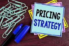 Handwriting text Pricing Strategy. Concept meaning Marketing sales strategies profit promotion campaign written on Sticky Note Pap. Handwriting text Pricing Royalty Free Stock Images