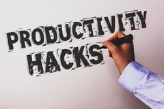 Handwriting text Productivity Hacks. Concept meaning Hacking Solution Method Tips Efficiency Productivity Advisors hand holding bl. Ack marker whiteboard written royalty free stock images