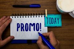 Handwriting text Promo Motivational Call. Concept meaning Piece of advertising Discount Special Offer Sale Marker pens notepad cup. Milk coffee daily memories royalty free stock images