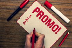 Handwriting text Promo Motivational Call. Concept meaning Piece of advertising Discount Special Offer Sale Three marker pens nice. Small pitch art paper lovely Royalty Free Stock Photography