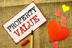 Handwriting text Property Value. Concept meaning Estimate of Worth Real Estate Residential Valuation written on Sticky Note Paper. Handwriting text Property royalty free stock photography