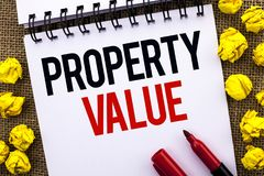 Handwriting text Property Value. Concept meaning Estimate of Worth Real Estate Residential Valuation written on Notebook Book on. Handwriting text Property Value stock images
