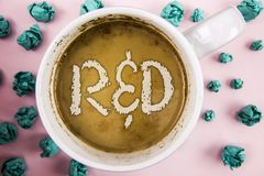 Handwriting text R D. Concept meaning Research and Development Scientific Investigations Innovations written on Coffee in White Cu. Handwriting text R D. Concept Royalty Free Stock Images