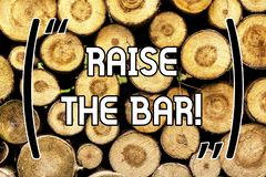 Handwriting text Raise The Bar. Concept meaning Set higher standards challenges seeking for excellence Wooden background. Vintage wood wild message ideas royalty free stock photo