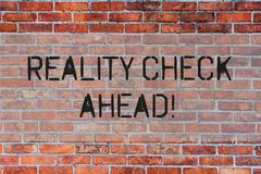 Handwriting text Reality Check Ahead. Concept meaning Unveil truth knowing actuality avoid being sceptical Brick Wall. Handwriting text Reality Check Ahead stock photo