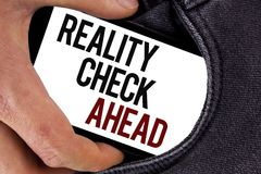 Handwriting text Reality Check Ahead. Concept meaning Unveil truth knowing actuality avoid being sceptical written on Mobile Scree. Handwriting text Reality royalty free stock photo