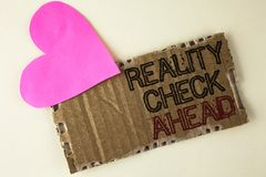 Handwriting text Reality Check Ahead. Concept meaning Unveil truth knowing actuality avoid being sceptical written on Tear Cardboa. Handwriting text Reality stock photo