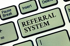 Handwriting text Referral System. Concept meaning sending own patient to another physician for treatment.  stock photo
