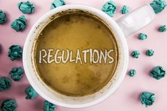 Handwriting text Regulations. Concept meaning Rules Laws Corporate Standards Policies Security Statements written on Coffee in Whi. Handwriting text Regulations Royalty Free Stock Image