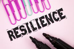 Handwriting text Resilience. Concept meaning Capacity to recover quickly from difficulties Persistence written on Plain Pink backg. Handwriting text Resilience Royalty Free Stock Images